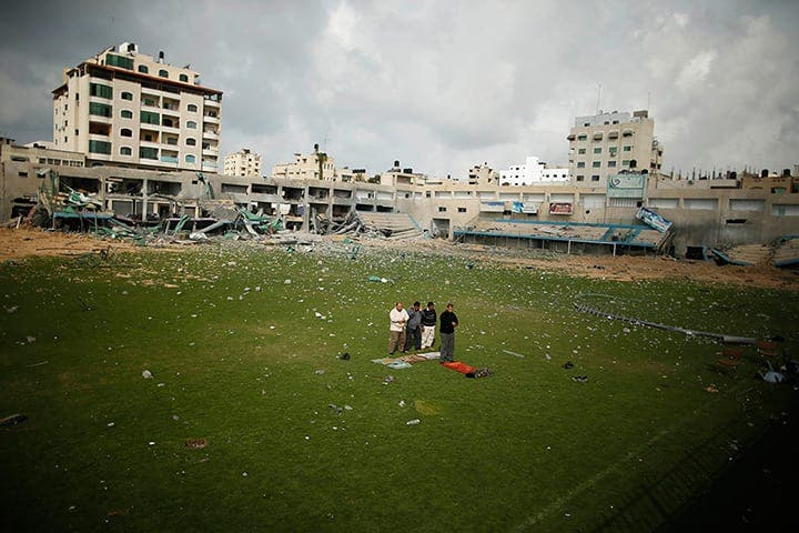 Gaza City, Gaza Strip: Palestinian security guards pray at football stadium