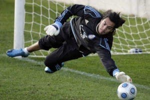 Argentina's goalkeeper Sergio Romero stops a ball during a training session in Madrid